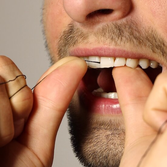 bamboo charcoacal dental floss by Yoni